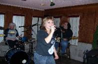 Liz having fun singing with the band